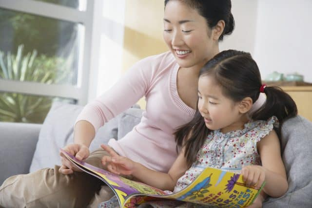 mom and daughter reading the Bible together