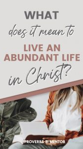 title What Does It Mean to Live an Abundant Life in Christ and woman reading a book